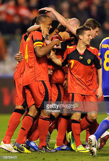 Vincent Kompany of Belgium is congratulated by teammates after scoring the 30 goal during the UEFA EURO 2012 Group A qualifying match between Belgium...