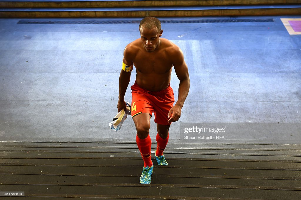<a gi-track='captionPersonalityLinkClicked' href=/galleries/search?phrase=Vincent+Kompany&family=editorial&specificpeople=504694 ng-click='$event.stopPropagation()'>Vincent Kompany</a> of Belgium shows his dejection while walking in the tunnel after the 0-1 defeat in the 2014 FIFA World Cup Brazil Quarter Final match between Argentina and Belgium at Estadio Nacional on July 5, 2014 in Brasilia, Brazil.