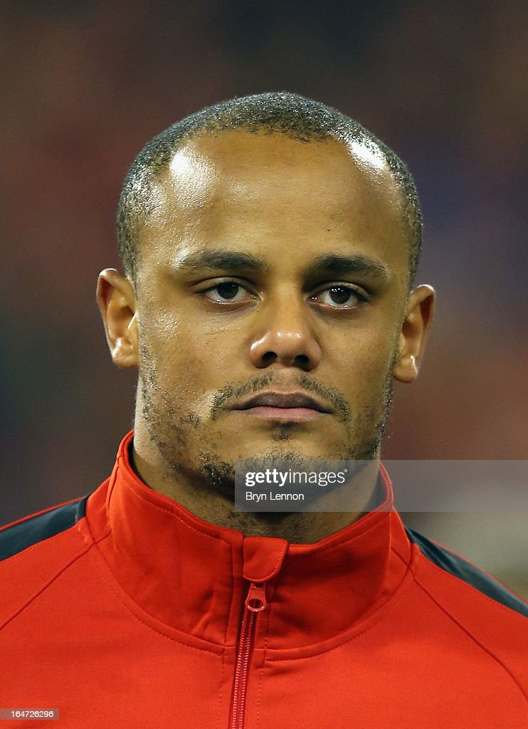 Vincent Kompany of Belgium stands for the national anthems prior to the FIFA 2014 World Cup Qualifier between Belgium and Macedonia at Stade Roi Baudouis on March 26, 2013 in Brussels, Belgium.
