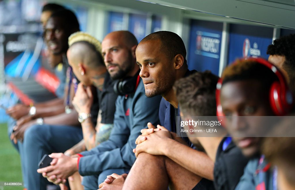 Vincent Kompany (C) of Belgium, withdrew from the tournament through injury, is seen with Beglium players prior to the UEFA EURO 2016 quarter final match between Wales and Belgium at Stade Pierre-Mauroy on July 1, 2016 in Lille, France.
