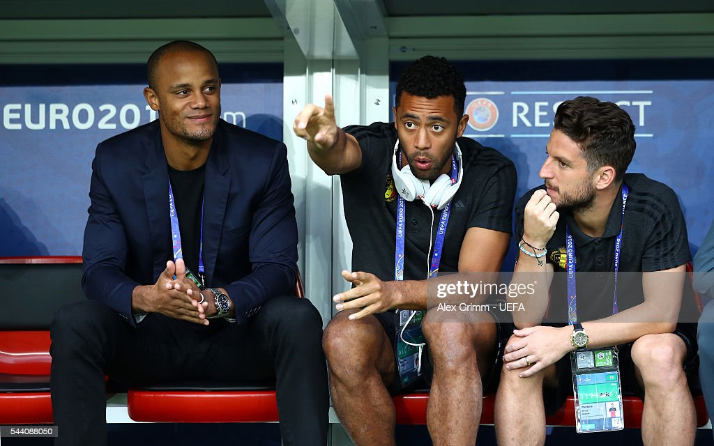 Vincent Kompany (L) of Belgium, withdrew from the tournament through injury, talks with Mousa Dembele (C) and Dries Mertens (R) prior to the UEFA EURO 2016 quarter final match between Wales and Belgium at Stade Pierre-Mauroy on July 1, 2016 in Lille, France.