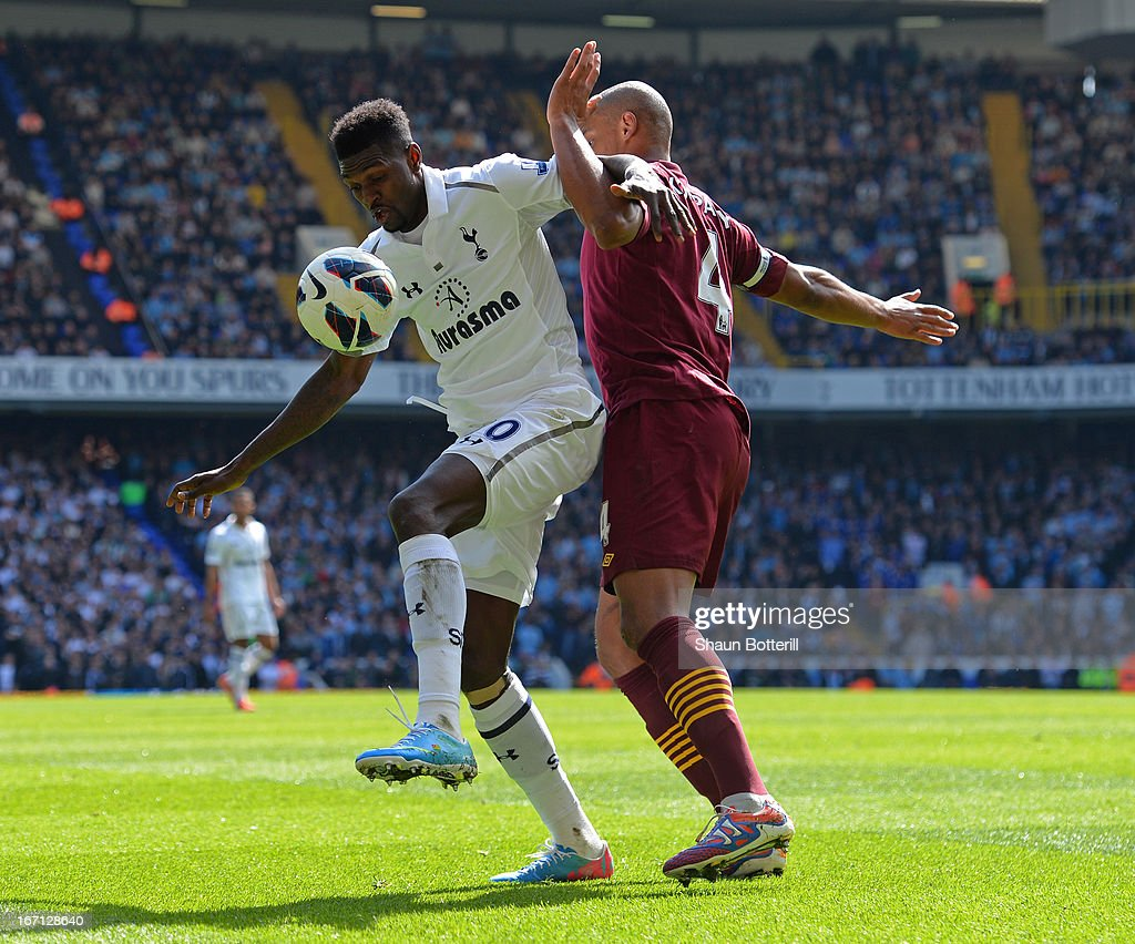Vincent Kompany of Manchester City and Emmanuel Adebayor of Tottenham Hotspur battle for the ball during the Barclays Premier League match between Tottenham Hotspur and Manchester City at White Hart Lane on April 21, 2013 in London, England.