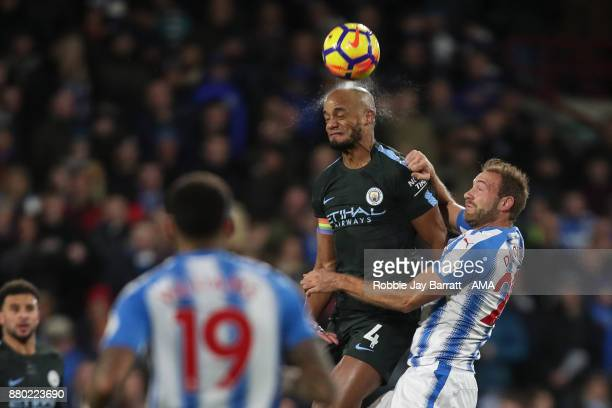 Vincent Kompany of Manchester City and Laurent Depoitre of Huddersfield Town during the Premier League match between Huddersfield Town and Manchester...