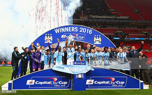 Vincent Kompany of Manchester City and team mates celebrate victory with the trophy after the Capital One Cup Final match between Liverpool and...