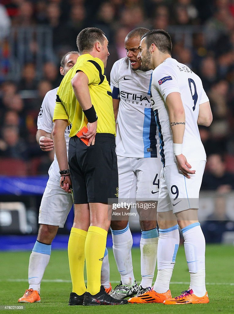 <a gi-track='captionPersonalityLinkClicked' href=/galleries/search?phrase=Vincent+Kompany&family=editorial&specificpeople=504694 ng-click='$event.stopPropagation()'>Vincent Kompany</a> of Manchester City argues with referee <a gi-track='captionPersonalityLinkClicked' href=/galleries/search?phrase=Stephane+Lannoy&family=editorial&specificpeople=2274380 ng-click='$event.stopPropagation()'>Stephane Lannoy</a> after Pablo Zabaleta is sent off during the UEFA Champions League Round of 16 match between FC Barcelona and Manchester City at Camp Nou on March 12, 2014 in Barcelona, Spain.