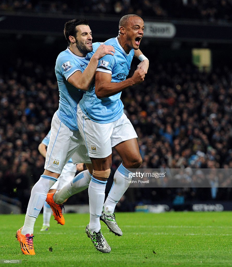 <a gi-track='captionPersonalityLinkClicked' href=/galleries/search?phrase=Vincent+Kompany&family=editorial&specificpeople=504694 ng-click='$event.stopPropagation()'>Vincent Kompany</a> of Manchester City celebrates after scoring the equlizing goal during the Barclays Premier League match between Manchester United and Liverpool at Etihad Stadium on December 26, 2013 in Manchester, England.