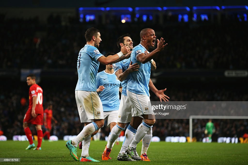 <a gi-track='captionPersonalityLinkClicked' href=/galleries/search?phrase=Vincent+Kompany&family=editorial&specificpeople=504694 ng-click='$event.stopPropagation()'>Vincent Kompany</a> of Manchester City celebrates his team's first goal during the Barclays Premier League match between Manchester City and Liverpool at Etihad Stadium on December 26, 2013 in Manchester, England.