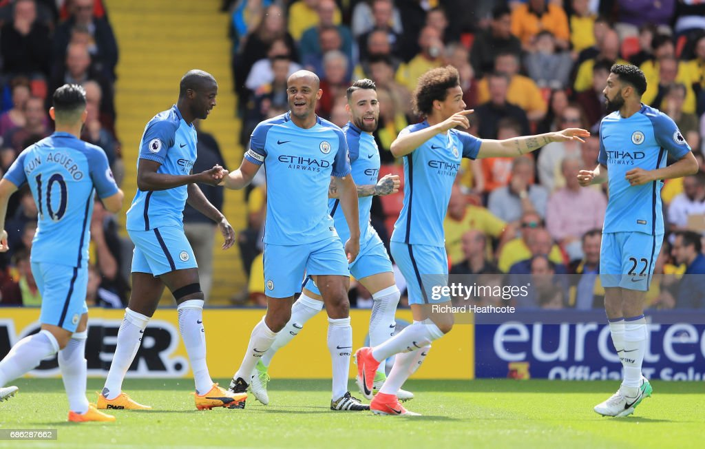 Vincent Kompany of Manchester City celebrates scoring his sides first goal with his Manchester City team mates during the Premier League match between Watford and Manchester City at Vicarage Road on May 21, 2017 in Watford, England.