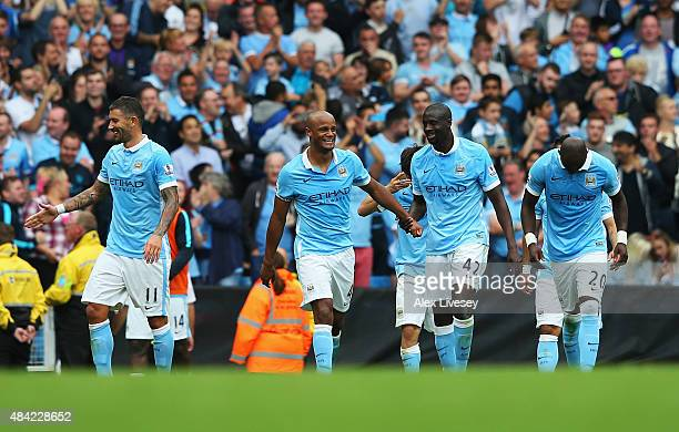 Vincent Kompany of Manchester City celebrates scoring his team's second goal with Yaya Toure of Manchester City during the Barclays Premier League...