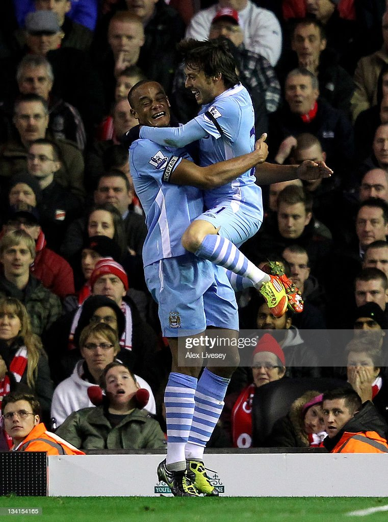 <a gi-track='captionPersonalityLinkClicked' href=/galleries/search?phrase=Vincent+Kompany&family=editorial&specificpeople=504694 ng-click='$event.stopPropagation()'>Vincent Kompany</a> of Manchester City celebrates scoring the opening goal with team mate <a gi-track='captionPersonalityLinkClicked' href=/galleries/search?phrase=David+Silva&family=editorial&specificpeople=675795 ng-click='$event.stopPropagation()'>David Silva</a> (R) during the Barclays Premier League match between Liverpool and Manchester City at Anfield on November 27, 2011 in Liverpool, England.