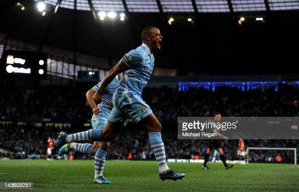 Vincent Kompany of Manchester City celebrates scoring the opening goal during the Barclays Premier League match between Manchester City and...