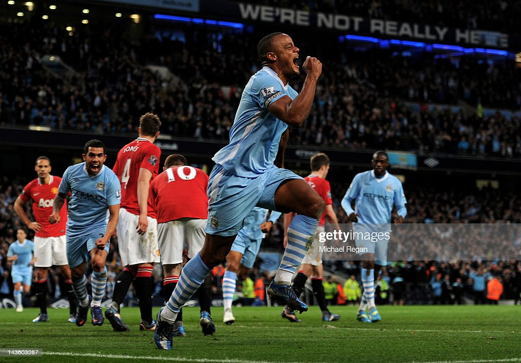 <a gi-track='captionPersonalityLinkClicked' href=/galleries/search?phrase=Vincent+Kompany&family=editorial&specificpeople=504694 ng-click='$event.stopPropagation()'>Vincent Kompany</a> of Manchester City celebrates scoring the opening goal during the Barclays Premier League match between Manchester City and Manchester United at the Etihad Stadium on April 30, 2012 in Manchester, England.
