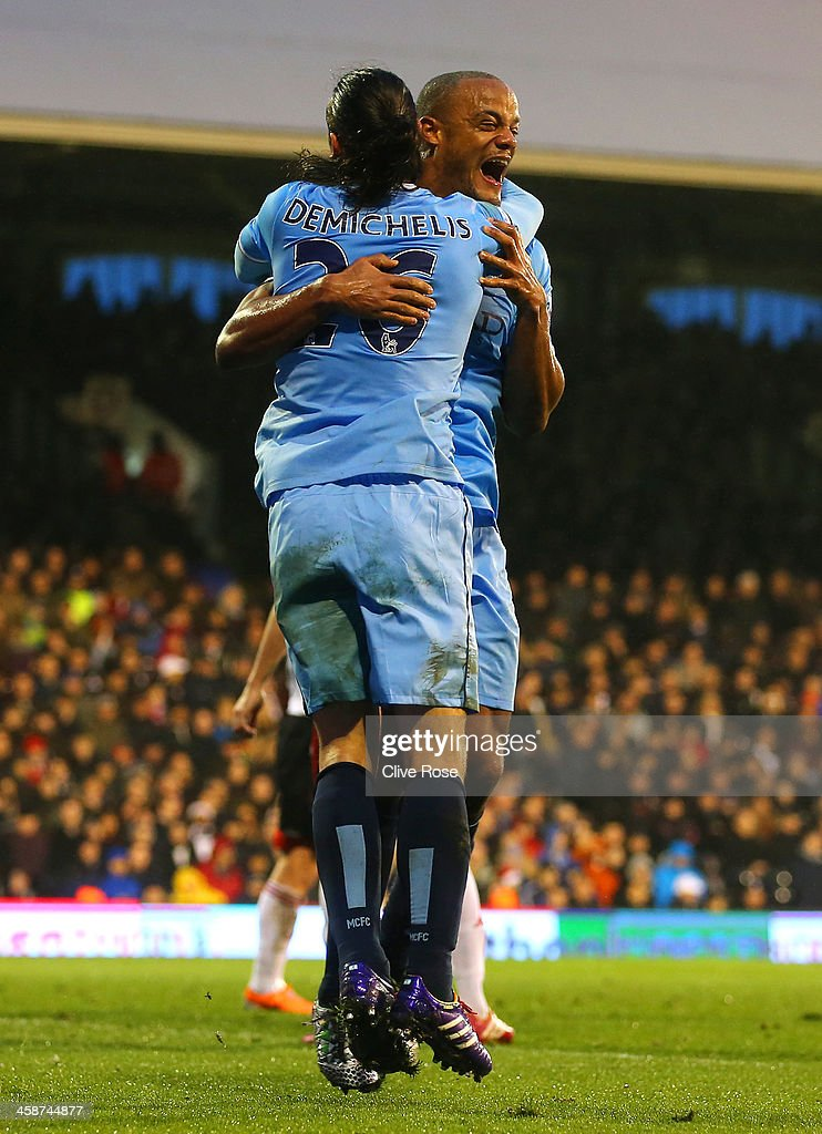 <a gi-track='captionPersonalityLinkClicked' href=/galleries/search?phrase=Vincent+Kompany&family=editorial&specificpeople=504694 ng-click='$event.stopPropagation()'>Vincent Kompany</a> of Manchester City celebrates scoring their second goal with <a gi-track='captionPersonalityLinkClicked' href=/galleries/search?phrase=Martin+Demichelis&family=editorial&specificpeople=240330 ng-click='$event.stopPropagation()'>Martin Demichelis</a> of Manchester City during the Barclays Premier League match between Fulham and Manchester City at Craven Cottage on December 21, 2013 in London, England.