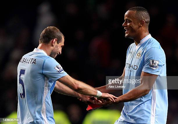 Vincent Kompany of Manchester City celebrates with team mate Pablo Zabaleta at the end of the Barclays Premier League match between Manchester City...