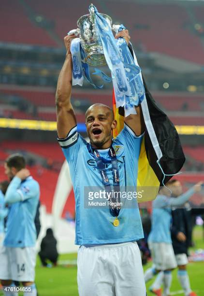 Vincent Kompany of Manchester City celebrates with the trophy after the Capital One Cup Final between Manchester City and Sunderland at Wembley...