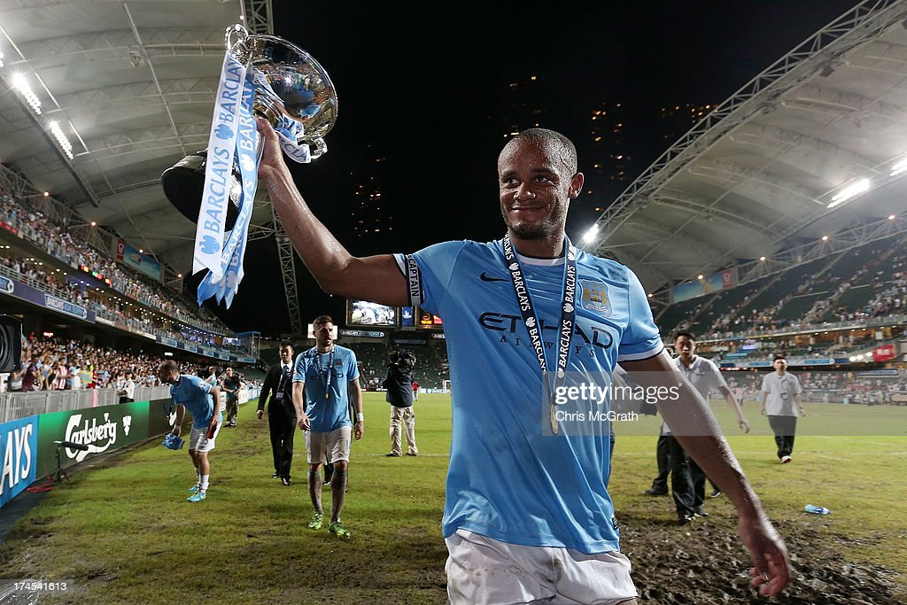<a gi-track='captionPersonalityLinkClicked' href=/galleries/search?phrase=Vincent+Kompany&family=editorial&specificpeople=504694 ng-click='$event.stopPropagation()'>Vincent Kompany</a> #4 of Manchester City celebrates with the trophy during the Barclays Asia Trophy Final match between Manchester City and Sunderland at Hong Kong Stadium on July 27, 2013 in So Kon Po, Hong Kong.