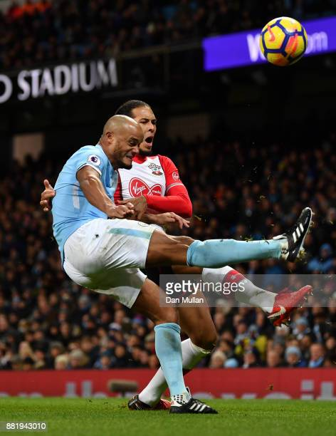 Vincent Kompany of Manchester City clears the ball while under pressure from Virgil van Dijk of Southampton during the Premier League match between...