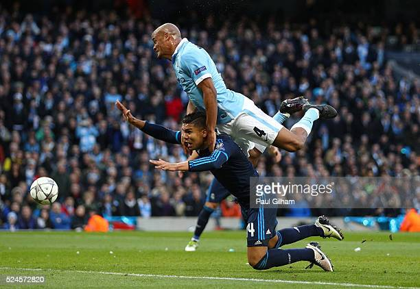 Vincent Kompany of Manchester City collides with Casemiro of Real Madrid CF during the UEFA Champions League Semi Final first leg match between...
