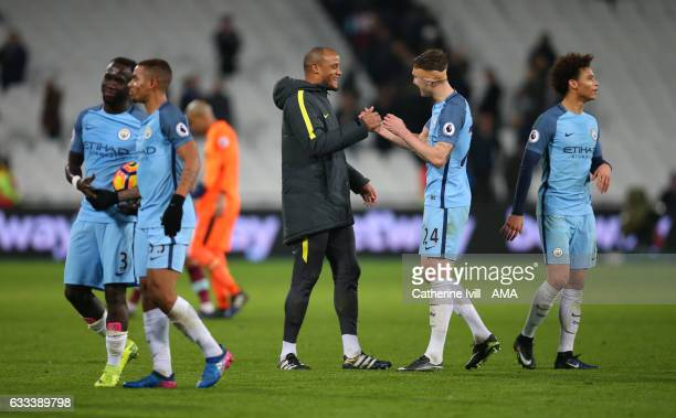 Vincent Kompany of Manchester City congratulates John Stones of Manchester City on the win during the Premier League match between West Ham United...