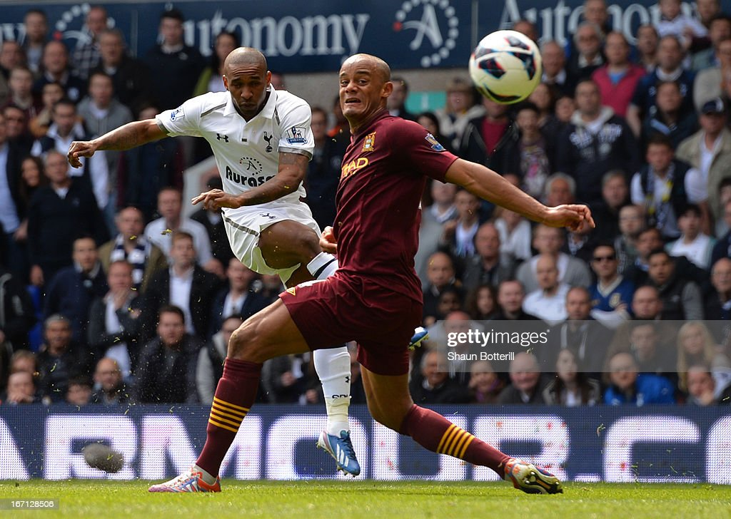Vincent Kompany of Manchester City fails to stop Jermain Defoe of Tottenham Hotspur scoring their second goal during the Barclays Premier League match between Tottenham Hotspur and Manchester City at White Hart Lane on April 21, 2013 in London, England.