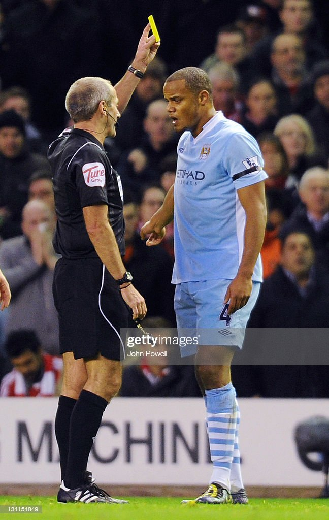 Vincent Kompany of Manchester City gets a yellow card during the Barclays Premier League match between Liverpool and Manchester City at Anfield on November 27, 2011 in Liverpool, England.