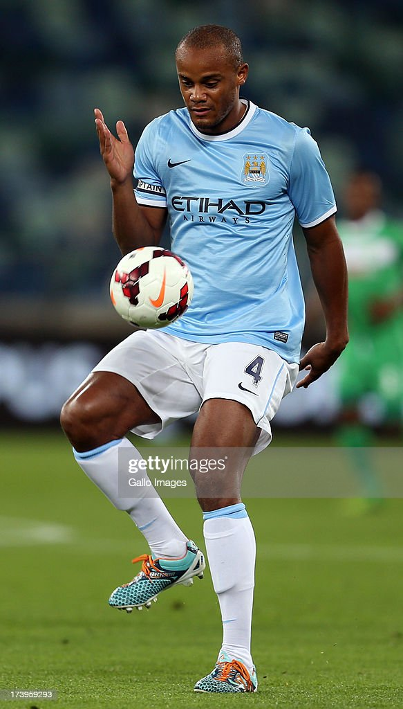 <a gi-track='captionPersonalityLinkClicked' href=/galleries/search?phrase=Vincent+Kompany&family=editorial&specificpeople=504694 ng-click='$event.stopPropagation()'>Vincent Kompany</a> of Manchester City in action during the Nelson Mandela Football Invitational match between AmaZulu and Manchester City at Moses Mabhida Stadium on July 18, 2013 in Durban, South Africa.