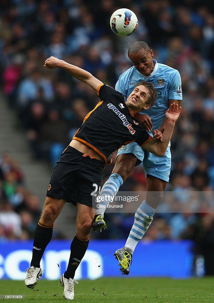 <a gi-track='captionPersonalityLinkClicked' href=/galleries/search?phrase=Vincent+Kompany&family=editorial&specificpeople=504694 ng-click='$event.stopPropagation()'>Vincent Kompany</a> of Manchester City in action with <a gi-track='captionPersonalityLinkClicked' href=/galleries/search?phrase=Kevin+Doyle+-+Soccer+Player&family=editorial&specificpeople=661496 ng-click='$event.stopPropagation()'>Kevin Doyle</a> of Wolverhampton Wanderers during the Barclays Premier League match between Manchester City and Wolverhampton Wanderers at Etihad Stadium on October 29, 2011 in Manchester, England.