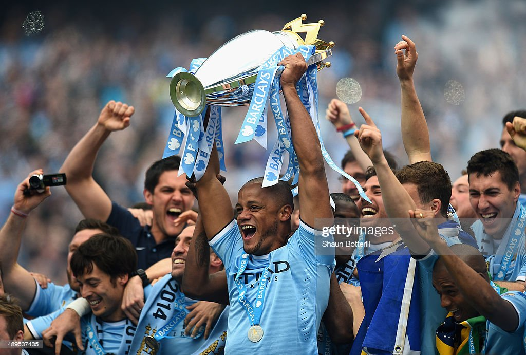 <a gi-track='captionPersonalityLinkClicked' href=/galleries/search?phrase=Vincent+Kompany&family=editorial&specificpeople=504694 ng-click='$event.stopPropagation()'>Vincent Kompany</a> of Manchester City lifts the Premier League trophy at the end of the Barclays Premier League match between Manchester City and West Ham United at the Etihad Stadium on May 11, 2014 in Manchester, England.