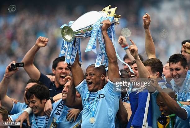 Vincent Kompany of Manchester City lifts the Premier League trophy at the end of the Barclays Premier League match between Manchester City and West...