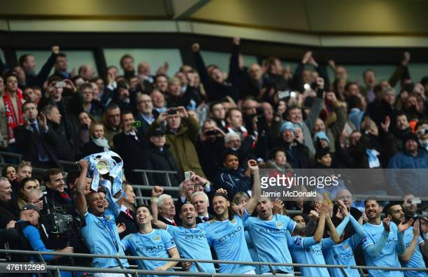 Vincent Kompany of Manchester City lifts the trophy with team mates after the Capital One Cup Final between Manchester City and Sunderland at Wembley...