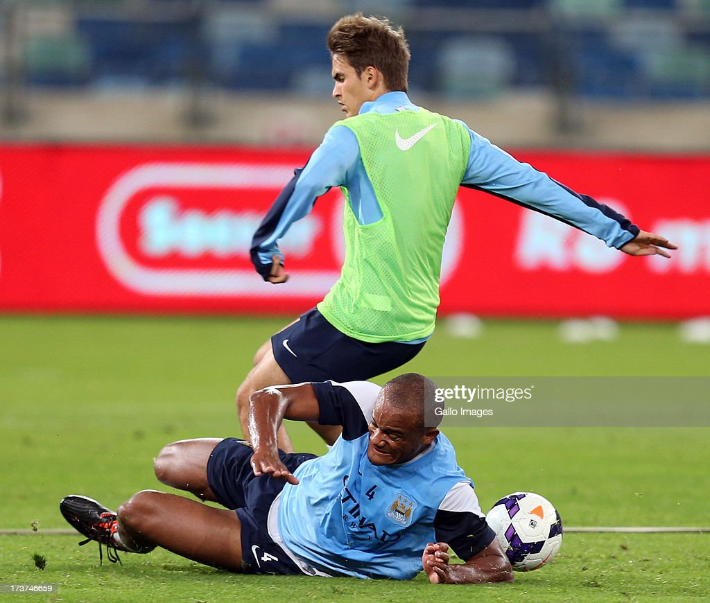 Vincent Kompany of Manchester City making a tackle during the Manchester City training session at Moses Mabhida Stadium on July 17, 2013 in Durban, South Africa.