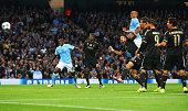 Vincent Kompany of Manchester City pressures Giorgio Chiellini of Juventus into scoring an own goal for their first during the UEFA Champions League...
