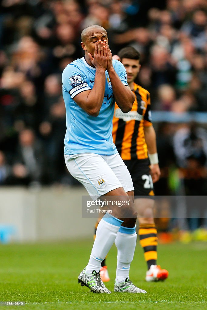 Vincent Kompany of Manchester City reacts after being shown the red card after bringing down Nikica Jelavic of Hull City during the Barclays Premier league match between Hull City and Manchester City at KC Stadium on March 15, 2014 in Hull, England.