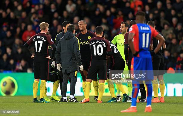 Vincent Kompany of Manchester City receives treatment from the medical team during the Premier League match between Crystal Palace and Manchester...