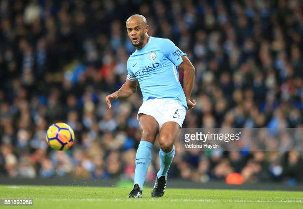 Vincent Kompany of Manchester City runs with the ball during the Premier League match between Manchester City and Southampton at Etihad Stadium on...