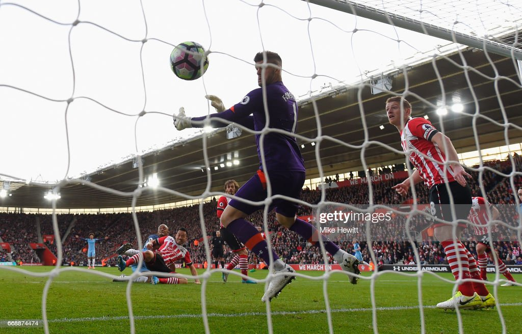 Vincent Kompany of Manchester City scores his sides first goal past Fraser Forster of Southampton during the Premier League match between Southampton and Manchester City at St Mary's Stadium on April 15, 2017 in Southampton, England.