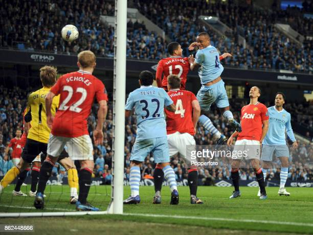Vincent Kompany of Manchester City scores past Chris Smalling and David De Gea during the Barclays Premier League match between Manchester City and...
