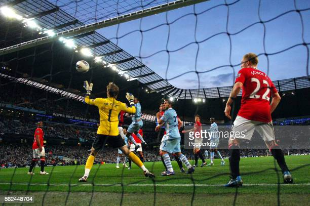 Vincent Kompany of Manchester City scores past David De Gea of Manchester United during the Barclays Premier League match between Manchester City and...