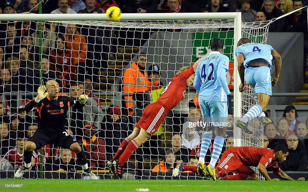 <a gi-track='captionPersonalityLinkClicked' href=/galleries/search?phrase=Vincent+Kompany&family=editorial&specificpeople=504694 ng-click='$event.stopPropagation()'>Vincent Kompany</a> of Manchester City scores the opening goal during the Barclays Premier League match between Liverpool and Manchester City at Anfield on November 27, 2011 in Liverpool, England.