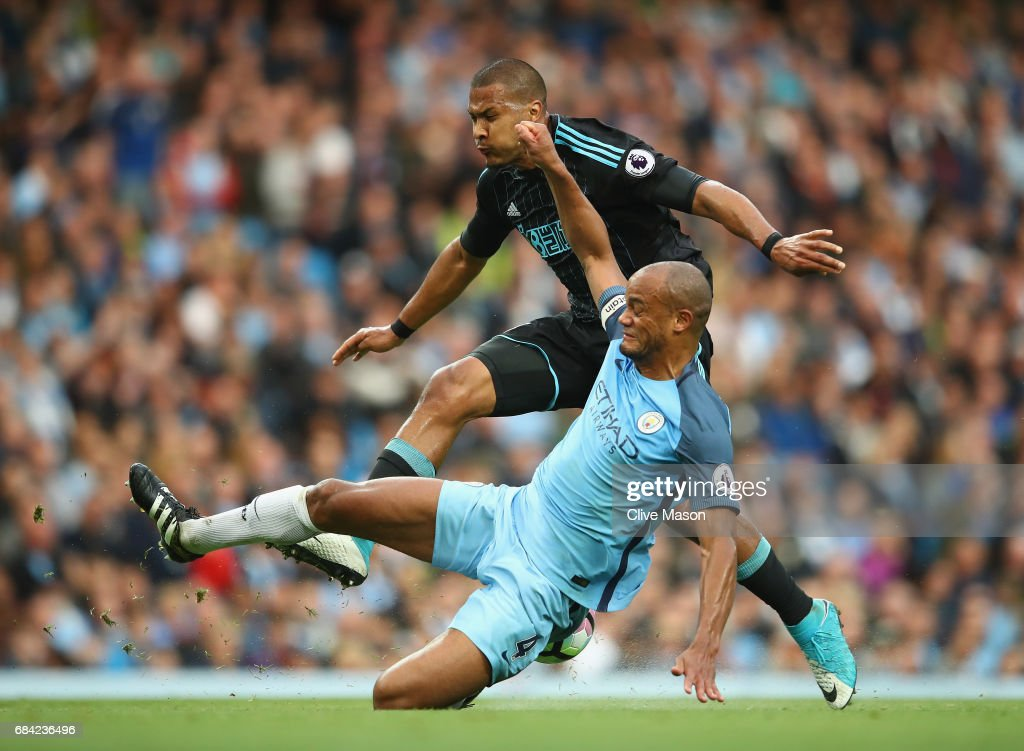 Vincent Kompany of Manchester City tackles Jose Salomon Rondon of West Bromwich Albion during the Premier League match between Manchester City and West Bromwich Albion at Etihad Stadium on May 16, 2017 in Manchester, England.