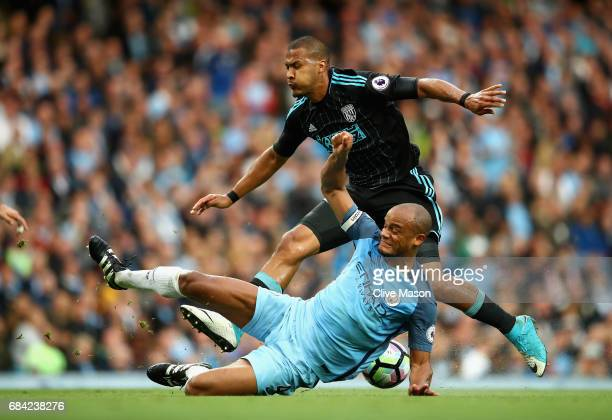 Vincent Kompany of Manchester City tackles Jose Salomon Rondon of West Bromwich Albion during the Premier League match between Manchester City and...