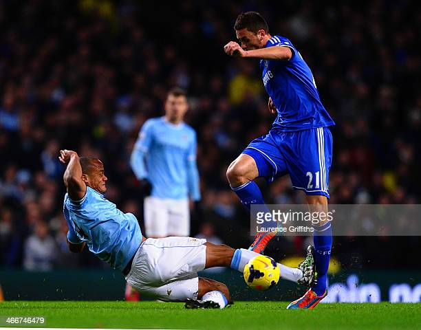 Vincent Kompany of Manchester City tackles Nemanja Matic of Chelsea during the Barclays Premier League match between Manchester City and Chelsea at...
