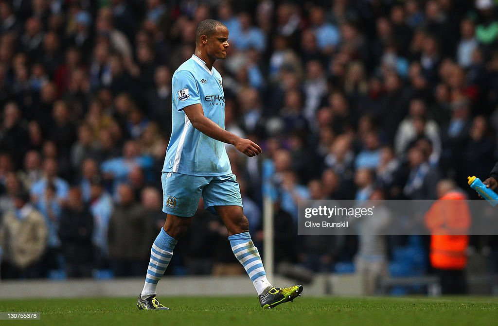 <a gi-track='captionPersonalityLinkClicked' href=/galleries/search?phrase=Vincent+Kompany&family=editorial&specificpeople=504694 ng-click='$event.stopPropagation()'>Vincent Kompany</a> of Manchester City walks off the pitch after being shown the red card during the Barclays Premier League match between Manchester City and Wolverhampton Wanderers at Etihad Stadium on October 29, 2011 in Manchester, England.