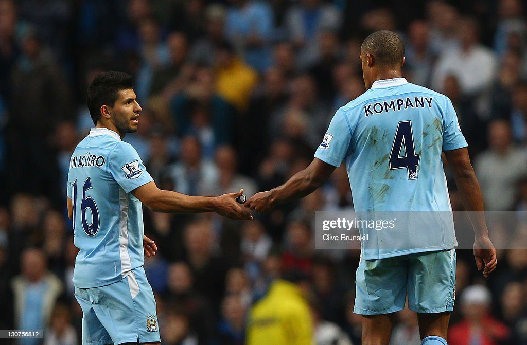 <a gi-track='captionPersonalityLinkClicked' href=/galleries/search?phrase=Vincent+Kompany&family=editorial&specificpeople=504694 ng-click='$event.stopPropagation()'>Vincent Kompany</a> of Manchester City walks off the pitch and hands team mate <a gi-track='captionPersonalityLinkClicked' href=/galleries/search?phrase=Sergio+Aguero&family=editorial&specificpeople=1100704 ng-click='$event.stopPropagation()'>Sergio Aguero</a> the captains arm band after being shown the red card during the Barclays Premier League match between Manchester City and Wolverhampton Wanderers at Etihad Stadium on October 29, 2011 in Manchester, England.