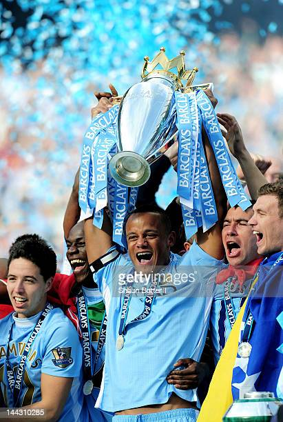 Vincent Kompany the captain of Manchester City lifts the trophy following the Barclays Premier League match between Manchester City and Queens Park...