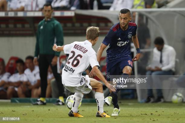 Vincent Koziello of OCG Nice Hakim Ziyech of Ajax during the UEFA Champions League third round qualifying first leg match between OGC Nice and Ajax...