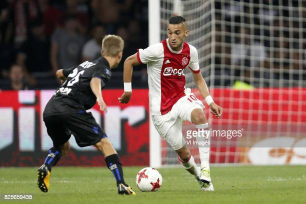 Vincent Koziello of OCG Nice Hakim Ziyech of Ajax during the UEFA Champions League third round qualifying first leg match between Ajax Amsterdam and...
