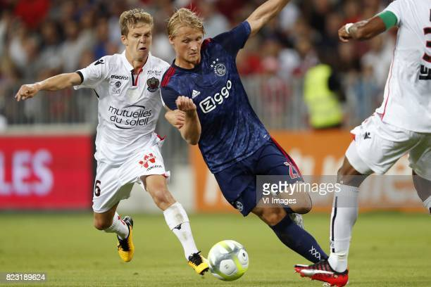 Vincent Koziello of OCG Nice Kasper Dolberg of Ajax Dante of OCG Nice during the UEFA Champions League third round qualifying first leg match between...