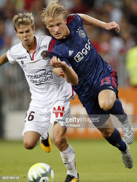 Vincent Koziello of OCG Nice Kasper Dolberg of Ajax during the UEFA Champions League third round qualifying first leg match between OGC Nice and Ajax...