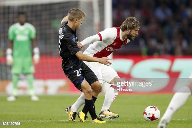 Vincent Koziello of OCG Nice Lasse Schone of Ajax during the UEFA Champions League third round qualifying first leg match between Ajax Amsterdam and...